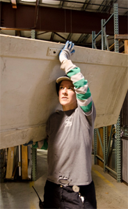 Kate Hill sorts used building materials as a Recycling worker for the ReBuilding Center